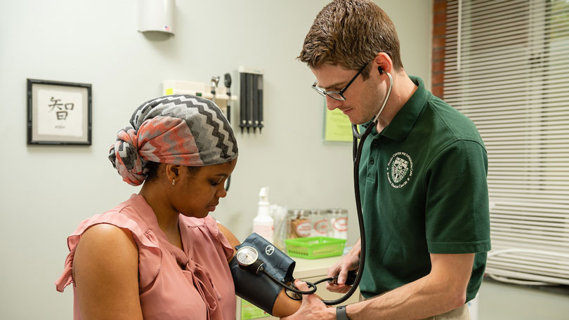 Picture of student in Hazen hall getting a blood pressure check.